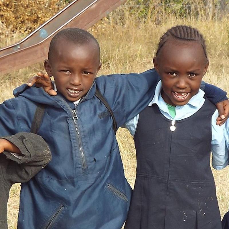 kenyan children linking arms